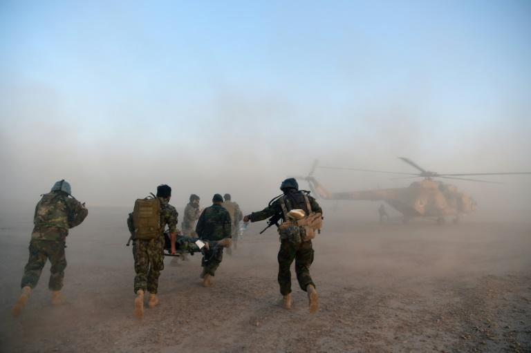 """A former Taliban commander in the southern province of Kandahar said some fighters were """"really tired"""" but could not surrender because their families were in Pakistan"""