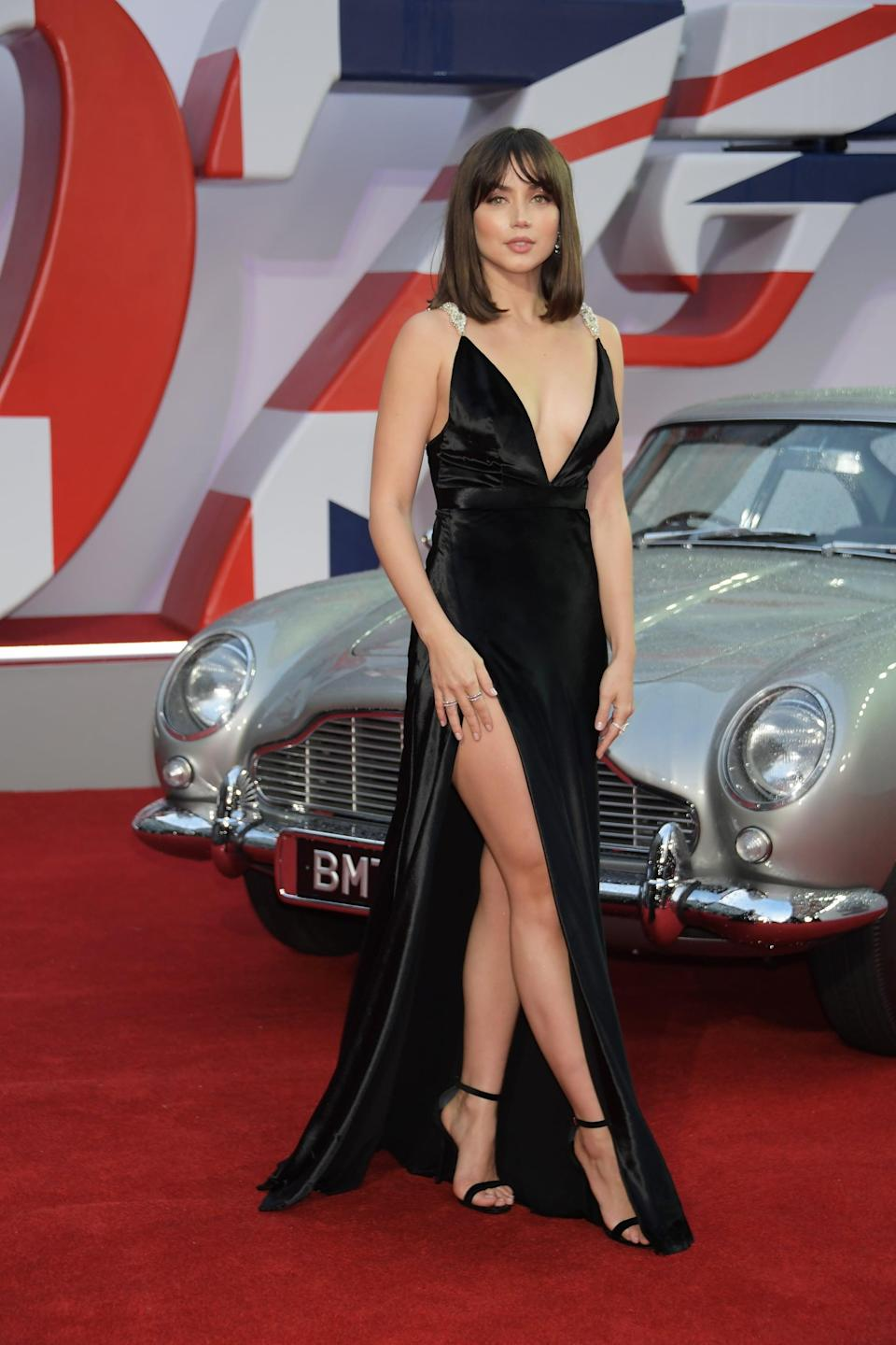 """<p>De Armas wore a <a href=""""https://www.popsugar.com/fashion/ana-de-armas-no-time-to-die-premiere-louis-vuitton-gown-48527668"""" class=""""link rapid-noclick-resp"""" rel=""""nofollow noopener"""" target=""""_blank"""" data-ylk=""""slk:custom Louis Vuitton dress"""">custom Louis Vuitton dress</a> that featured a plunging neckline, a thigh-high slit, and embellished straps. She accessorized with diamonds supplied by Chopard. </p>"""