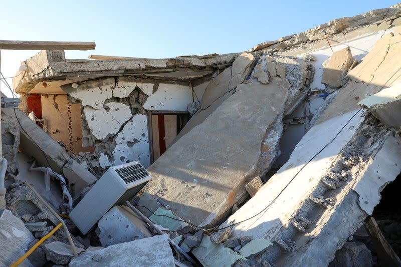 FILE PHOTO: Damage is seen after shells fell on a residential area, in Abu Slim district south of Tripoli