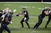 New Orleans Saints quarterback Drew Brees (9) drops back to pass in the first half of an NFL football game against the San Francisco 49ers in New Orleans, Sunday, Nov. 15, 2020. (AP Photo/Butch Dill)