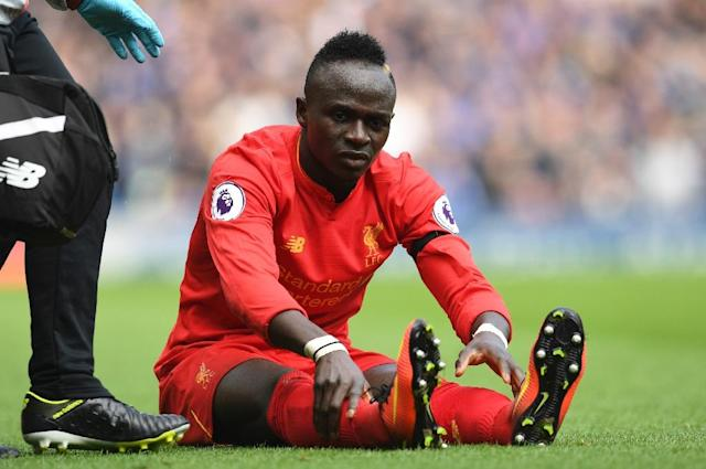Liverpool forward Sadio Mane is injured during the English Premier League match against Everton at Anfield on April 1, 2017 (AFP Photo/Paul ELLIS)