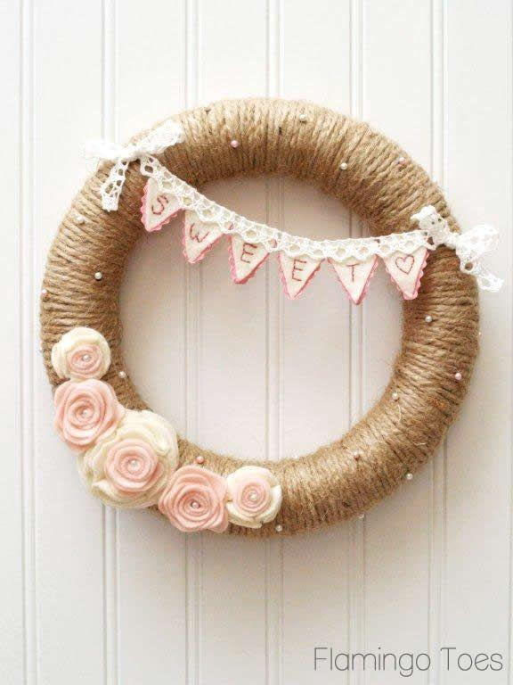 """<p>The contrast of the pearl stick pins against the natural jute twine is part of this lovely wreath's appeal, and so is the adorable little sweetheart banner.</p><p><strong>Get the tutorial at <a href=""""https://flamingotoes.com/sweetheart-valentines-day-wreath/"""" rel=""""nofollow noopener"""" target=""""_blank"""" data-ylk=""""slk:Flamingo Toes"""" class=""""link rapid-noclick-resp"""">Flamingo Toes</a>.</strong></p><p><a class=""""link rapid-noclick-resp"""" href=""""https://www.amazon.com/KUTONTECH-Industrial-Materials-Gardening-Recycling/dp/B089H2W3GQ/ref=asc_df_B089H2W3GQ/?tag=syn-yahoo-20&ascsubtag=%5Bartid%7C10050.g.35057743%5Bsrc%7Cyahoo-us"""" rel=""""nofollow noopener"""" target=""""_blank"""" data-ylk=""""slk:SHOP JUTE ROLLS"""">SHOP JUTE ROLLS</a><br></p>"""