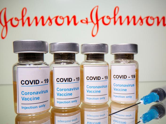 <p>Vials with a sticker reading, 'Covid-19 / Coronavirus vaccine / Injection only' and a medical syringe are seen in front of a displayed Johnson & Johnson logo in this illustration taken 31 October, 2020</p> (REUTERS)