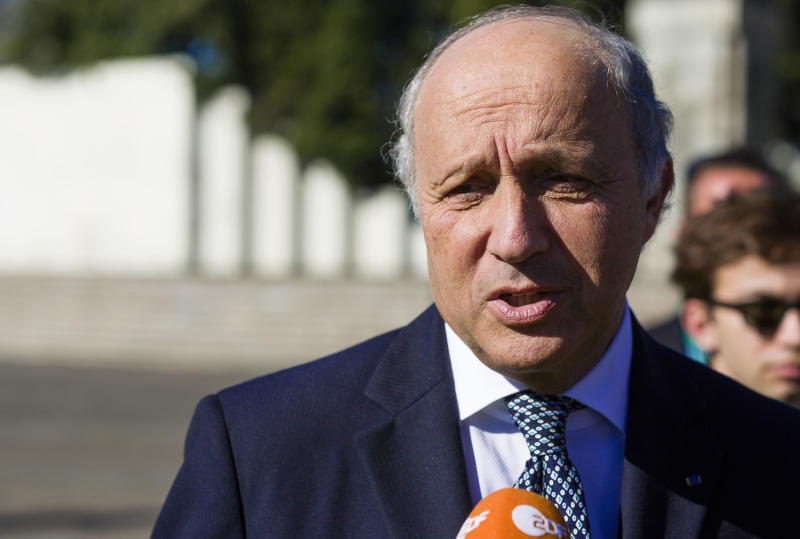 France's Minister for Foreign and European Affairs Laurent Fabius speaks to reporters during the Informal Meeting of EU Ministers for Foreign Affairs at the National Gallery of Art in Vilnius, Lithuania, Friday, Sept. 6, 2013. (AP Photo/Mindaugas Kulbis)