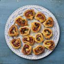 """<p>Don't expect these cheesy roll-ups to stay on the platter for very long. (And be prepared to share the recipe with curious guests, too!)</p><p><strong><a href=""""https://www.thepioneerwoman.com/food-cooking/recipes/a34691212/eddie-jackson-sausage-pinwheels-recipe/"""" rel=""""nofollow noopener"""" target=""""_blank"""" data-ylk=""""slk:Get the recipe"""" class=""""link rapid-noclick-resp"""">Get the recipe</a>.</strong></p><p><a class=""""link rapid-noclick-resp"""" href=""""https://go.redirectingat.com?id=74968X1596630&url=https%3A%2F%2Fwww.walmart.com%2Fbrowse%2Fhome%2Fthe-pioneer-woman-dishes%2F4044_623679_639999_7373615&sref=https%3A%2F%2Fwww.thepioneerwoman.com%2Ffood-cooking%2Fmeals-menus%2Fg32157273%2Ffourth-of-july-appetizers%2F"""" rel=""""nofollow noopener"""" target=""""_blank"""" data-ylk=""""slk:SHOP PLATES"""">SHOP PLATES</a></p>"""