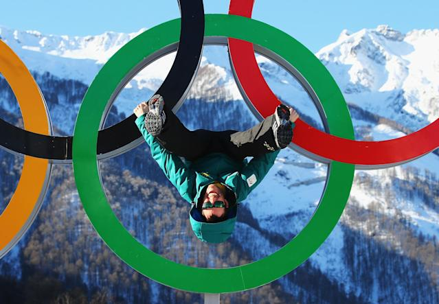SOCHI, RUSSIA - FEBRUARY 06: Australian arial skiier Dave Morris poses on the Olympic Rings in the Athletes Village ahead of the Sochi 2014 Winter Olympics at Rosa Khutor on February 6, 2014 in Sochi, Russia. (Photo by Al Bello/Getty Images)
