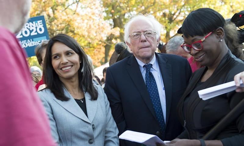 Bernie Sanders waits alongside Gabbard to speak during a rally to stop the Trans-Pacific Partnership in Washington DC, 17 November 2016.