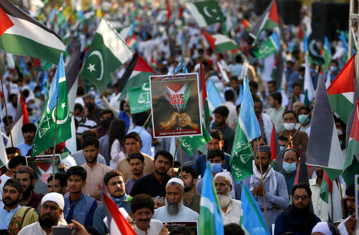Supporters of the Pakistani religious group' Jamaat-e-Islami' take part in a rally in support of Palestinians, in Islamabad, Pakistan, Friday, May 21, 2021. (AP Photo/Anjum Naveed)