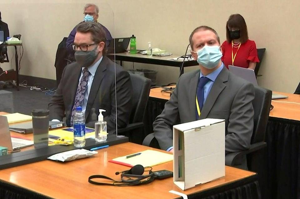 <p>Derek Chauvin (right) at the start of the trial.</p> (Reuters)