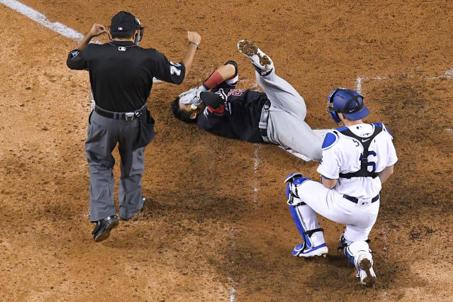 Washington Nationals' Kurt Suzuki (28) holds his head after being hit by a pitch from Los Angeles Dodgers' Walker Buehler during the seventh inning in Game 5 of a baseball National League Division Series on Wednesday, Oct. 9, 2019, in Los Angeles. (AP Photo/Mark J. Terrill)