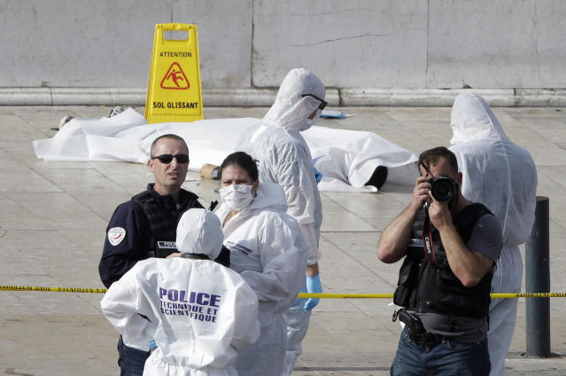 <p>Investigative police officer work by a body under a white sheet outside Marseille 's main train station Oct. 1, 2017 in Marseille, southern France. (AP Photo/Claude Paris) </p>