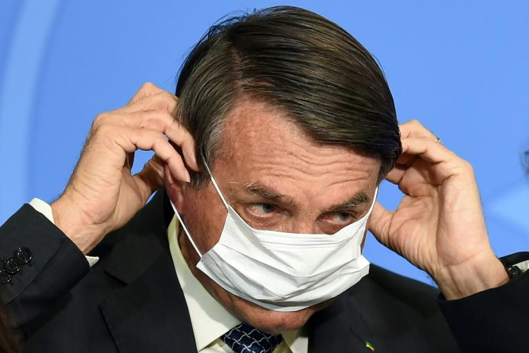 Brazil's Bolsonaro threatens to punch reporter in the mouth