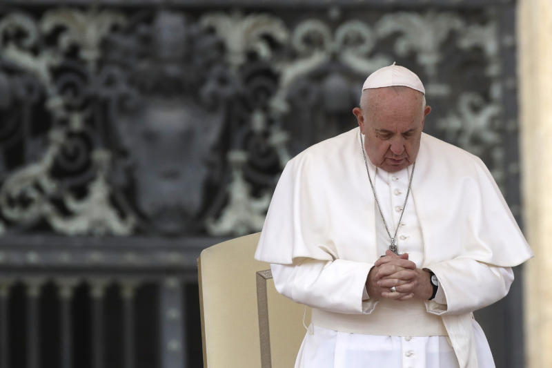 Pope Francis prays in St. Peter's Square at the Vatican during his weekly general audience, Wednesday, Feb. 26, 2020. (AP Photo/Alessandra Tarantino)