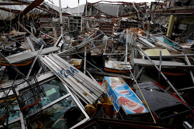 <p>Damages are seen in a supermarket after the area was hit by Hurricane Maria in Guayama, Puerto Rico, Sept. 20, 2017. (Photo: Carlos Garcia Rawlins/Reuters) </p>