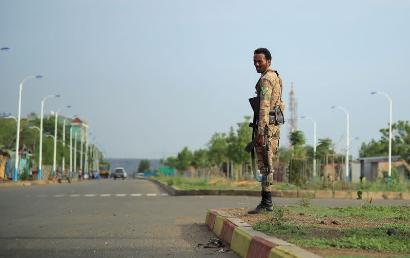 Member of Amhara Special Forces stands guard along a street in Humera town