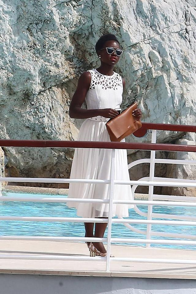 <p>The <em>Star Wars: The Force Awakens</em> actress looked ethereal in a white dress with flowy skirt as she stood poolside at Hotel du Cap-Eden-Roc. (Photo: Splash News) </p>