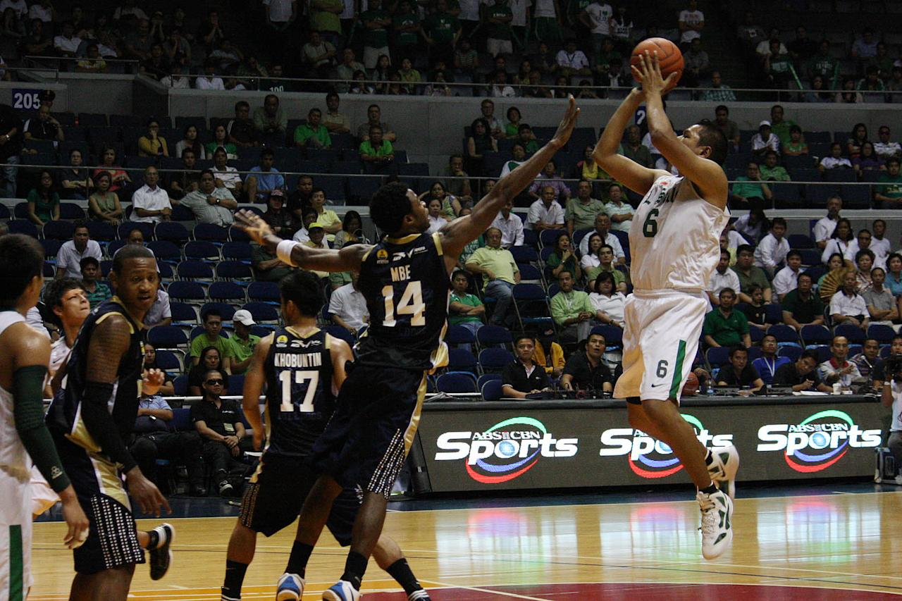 Norbert Torres of De La Salle Green Archers shoots the ball during the UAAP Season 74 basketball game against NU Bulldogs at Smart Araneta Coliseum in Quezon City. (Marlo Cueto/NPPA Images)