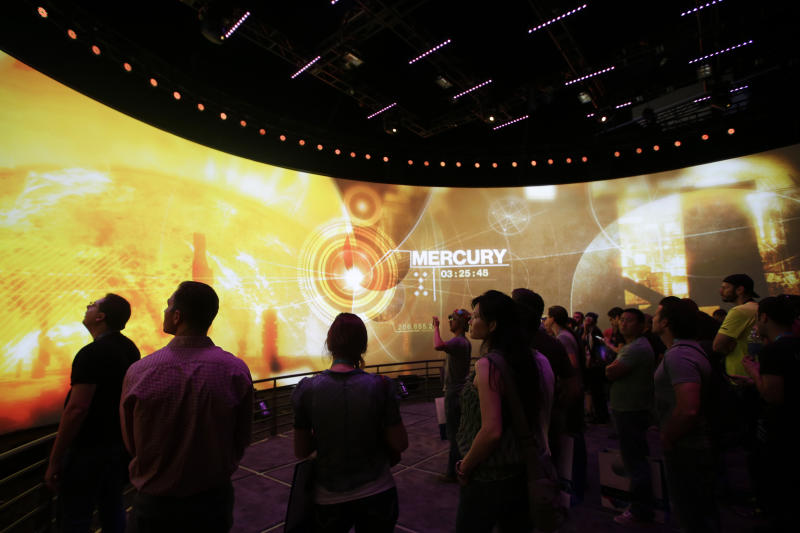 "Show attendees watch a presentation on the video game ""Destiny"" at the Activision Blizzard Booth during the Electronic Entertainment Expo in Los Angeles, Thursday, June 13, 2013. (AP Photo/Jae C. Hong)"