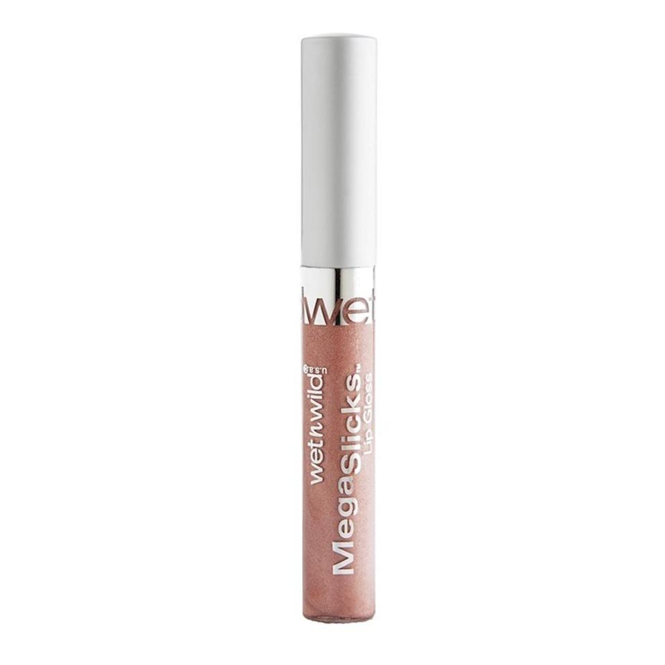 "<p>If you stop to peruse the makeup section of CVS every time you run in to grab a box of tissues or a Tide to Go stick, you've probably come across this shimmery lip gloss. It's been a staple for years because the formula has everything you could need from a straightforward lip gloss: long-lasting high shine with no stickiness — and it only costs 8 quarters.</p><strong>Wet N' Wild</strong>, $1.99, available at <a href=""https://jet.com/product/Wet-N-Wild-MegaSlicks-Lip-Gloss-Bronze-Berry/fdda69d7e7a6463ab2e6d33417829e51?beaconId=cd61d771-5325-4e76-880d-7b022b11c2aa%2F1%2Fx~fdda69d7e7a6463ab2e6d33417829e51&origination=PLP"" rel=""nofollow noopener"" target=""_blank"" data-ylk=""slk:Jet"" class=""link rapid-noclick-resp"">Jet</a>"