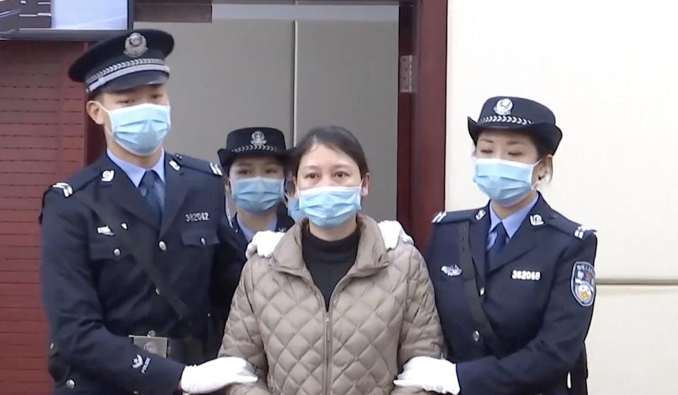 Lao was captured in a shopping mall in Xiamen where she sold watches in November 2019 after a police database helped uncover her true identity. Photo: CCTV