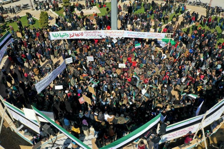 An aerial view shows displaced Syrians demonstrating against President Bashar al-Assad and the upcoming presidential election in the rebel-held city of Idlib on February 19, 2021