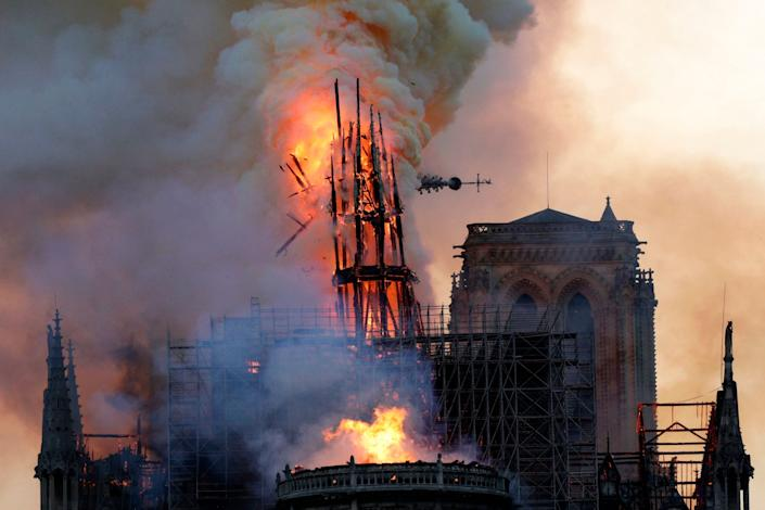 The steeple collapses as smoke and flames engulf the Notre-Dame Cathedral in Paris on April 15, 2019. (Photo: Geoffroy Van Der Hasselt/AFP/Getty Images)