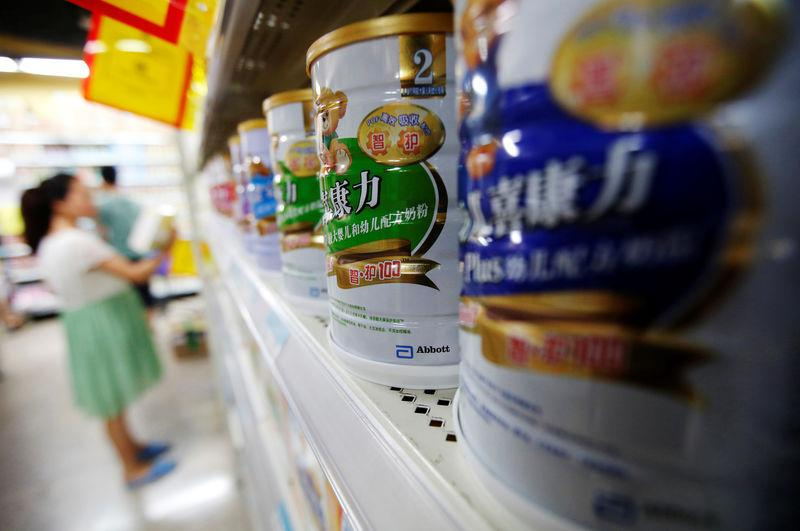 Abbott's milk powder products are displayed on a shelf at a supermarket in Beijing