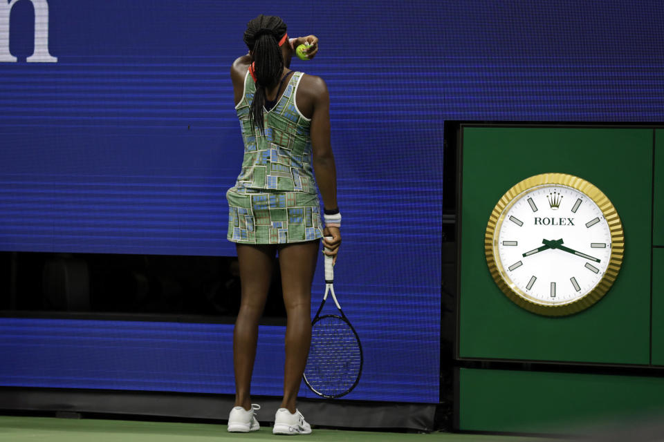 Coco Gauff wipes her face during a match against against Naomi Osaka, of Japan, in the third round of the U.S. Open tennis tournament Saturday, Aug. 31, 2019, in New York. (AP Photo/Adam Hunger)