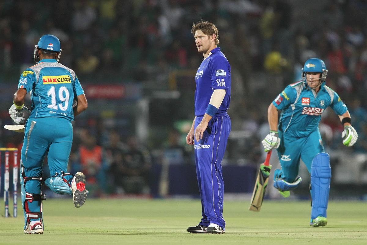 Shane Watson of Rajasthan Royals looks on as Robin Uthappa of Pune Warriors India and Pune Warriors India captain Aaron Finch take a run during match 50 of the Pepsi Indian Premier League (IPL) 2013 between The Rajasthan Royals and the Pune Warriors India held at the Sawai Mansingh Stadium in Jaipur on the 5th May 2013..Photo by Shaun Roy-IPL-SPORTZPICS ..Use of this image is subject to the terms and conditions as outlined by the BCCI. These terms can be found by following this link:..https://ec.yimg.com/ec?url=http%3a%2f%2fwww.sportzpics.co.za%2fimage%2fI0000SoRagM2cIEc&t=1498369236&sig=0BWv3wp1n7DXsH6PVGB.rg--~C