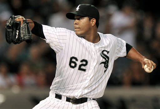 Chicago White Sox starter Jose Quintana delivers a pitch during the first inning of the second game of a doubleheader baseball game against the Cleveland Indians in Chicago, Friday, June 28, 2013. (AP Photo/Paul Beaty)