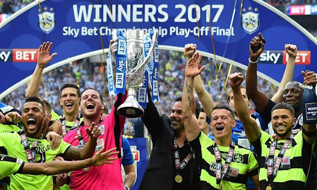 Huddersfield celebrate beating Reading on penalties in the play-off final. How long will the smiles last?