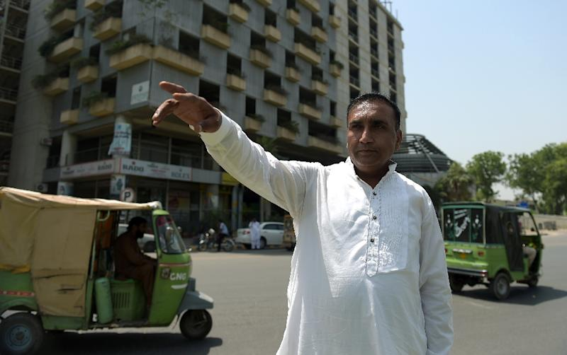 Pakistani bus driver Meher Khalil, who drove the Sri Lankan cricket team to safety when it came under a gun and grenade attack by militants in March 2009, speaks to AFP at the site of the attack in Lahore on May 21, 2015 (AFP Photo/Aamir Qureshi)
