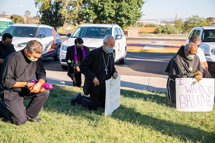 Bishop Seitz and other Catholic clergy take the knee during a Black Lives Matter rally in Memorial Park, on June 1, 2020.
