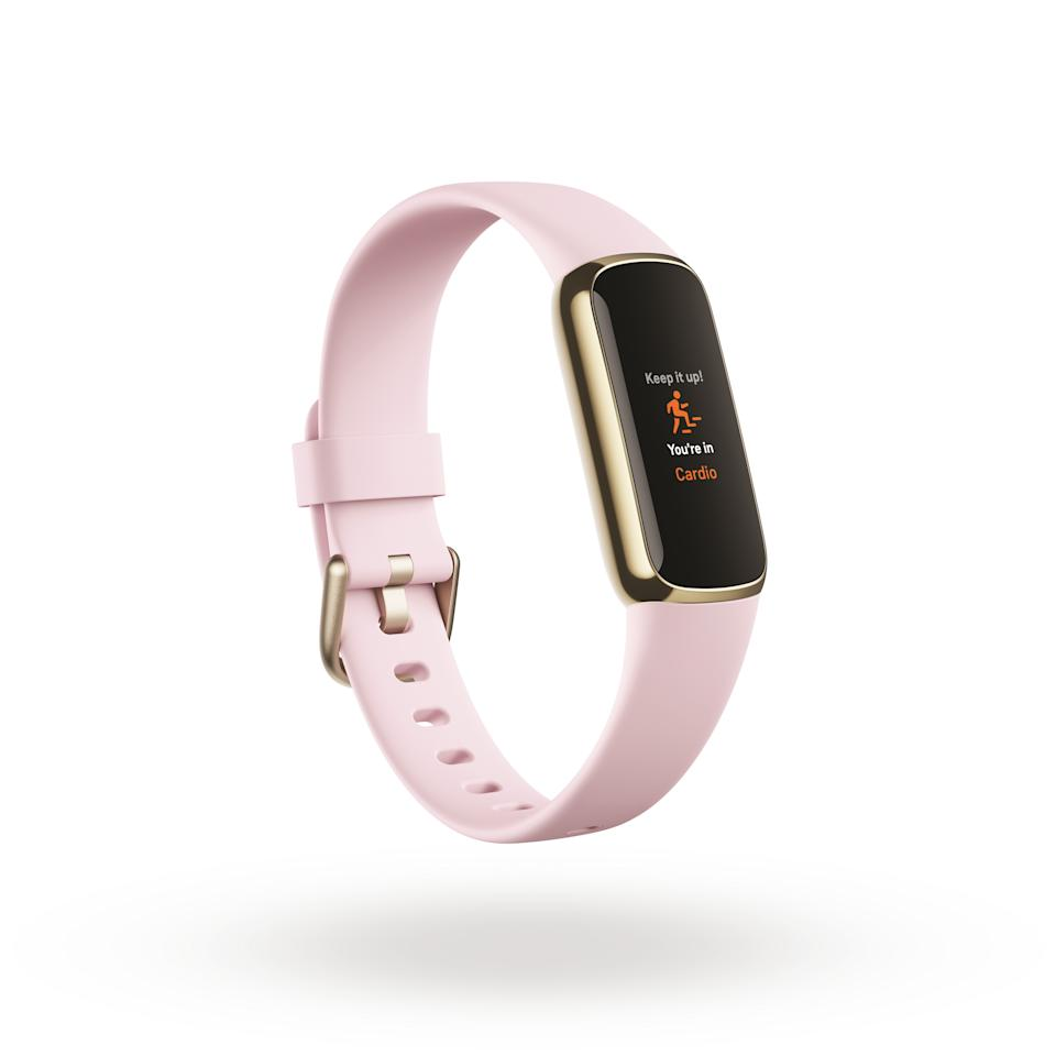 <p>Product render of Fitbit Luxe 3QTR view, in Peony and Soft Gold.</p>