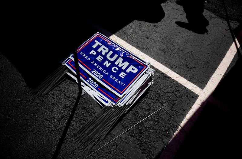 Yard signs for President Donald Trump are seen during a Republican voter registration in Brownsville