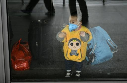 This young Shanghai subway passenger is taking the same precautions adults do for protection against the deadly virus