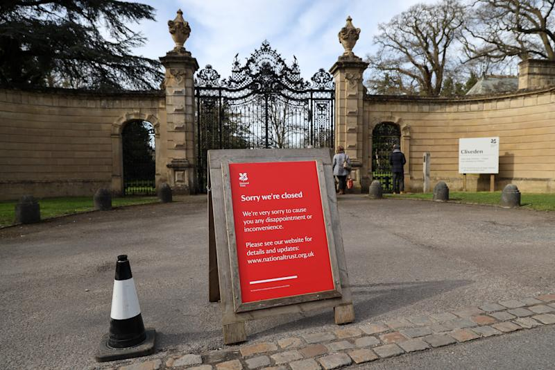 "BURNHAM, UNITED KINGDOM - MARCH 21: A sign outside Cliveden telling visitors they are closed after too many visitors arrived early to walk around the grounds on March 21, 2020 in Burnham, United Kingdom. The National Trust, a charitable organisation that manages private parkland across the United Kingdom, said that during the COVID-19 outbreak it plans ""to keep as many of our gardens and parklands open, free of charge, alongside coast and countryside, to encourage the nation to enjoy open space, while observing social distancing measures."" (Photo by Richard Heathcote/Getty Images)"