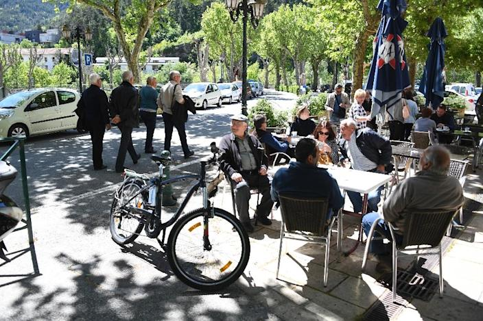 The sleepy cobbled streets of Puget-Theniers are a far cry from Macron's campaign headquarters in Paris, full of 20-somethings in trainers rushing to meetings with their laptops (AFP Photo/Yann COATSALIOU)