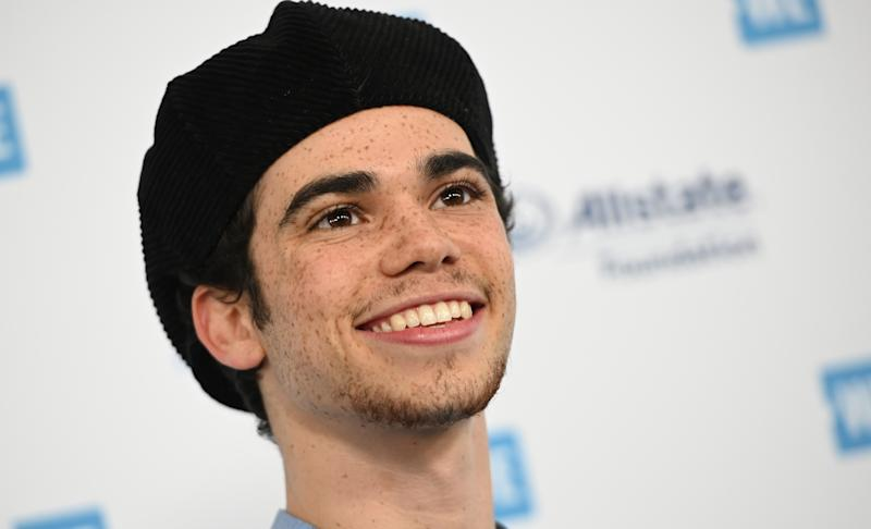 Actor Cameron Boyce arrives for WE Day California at the Forum in Inglewood, California on April 25, 2019. - WE Day is the worlds largest youth empowerment event combining the energy of a live concert with the inspiration of extraordinary stories of leadership and change. WE Day California will bring together world-renowned speakers and award-winning performers to celebrate the tens of thousands of young people from across California who have made a difference in their community. (Photo by Robyn BECK / AFP) (Photo credit should read ROBYN BECK/AFP via Getty Images)