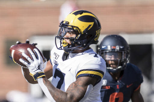 Michigan's Tarik Black (7) makes a catch in front of Illinois defender Nate Hobbs (8) in the second half of an NCAA college football game, Saturday, Oct. 12, 2019, in Champaign, Ill. (AP Photo/Holly Hart)