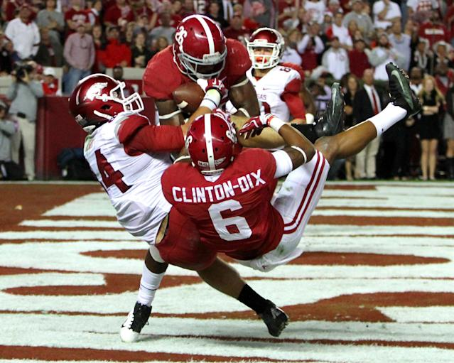 Alabama defensive back Landon Collins (26) and Alabama defensive back Ha Ha Clinton-Dix (6) break up a pass intended for Arkansas tight end Hunter Henry (84) in the end zone during the first half of an NCAA college football game on Saturday, Oct. 19, 2013, in Tuscaloosa, Ala. (AP Photo/Butch Dill)