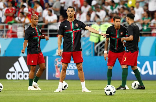 Soccer Football - World Cup - Group B - Iran vs Portugal - Mordovia Arena, Saransk, Russia - June 25, 2018 Portugal's Cristiano Ronaldo with team mates during the warm up before the match REUTERS/Murad Sezer