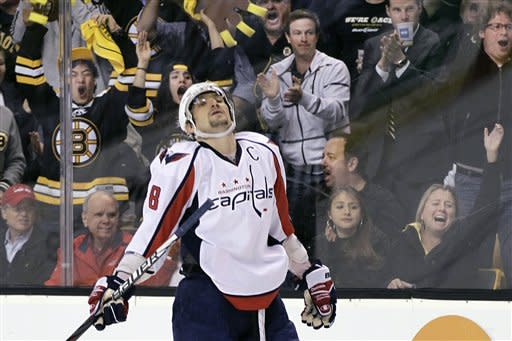 Fans cheer as Washington Capitals left wing Alex Ovechkin reacts after he couldn't score against the Boston Bruins during the third period of Game 7 of an NHL hockey Stanley Cup first-round playoff series, in Boston on Wednesday, April 25, 2012. (AP Photo/Elise Amendola)