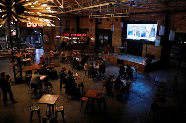 PHOTO: People watch the first 2020 presidential campaign debate between President Donald Trump and Democratic presidential nominee Joe Biden, at the Pinche Gringo restaurant in Mexico City, Mexico, Sept. 29, 2020. (Carlos Jasso/Reuters, FILE)