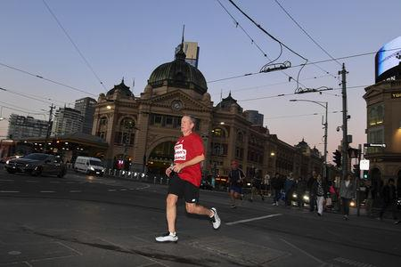 Australian Opposition Leader Bill Shorten is seen during a morning run in Melbourne, Australia, May 18, 2019. AAP Image/Lukas Coch/via REUTERS