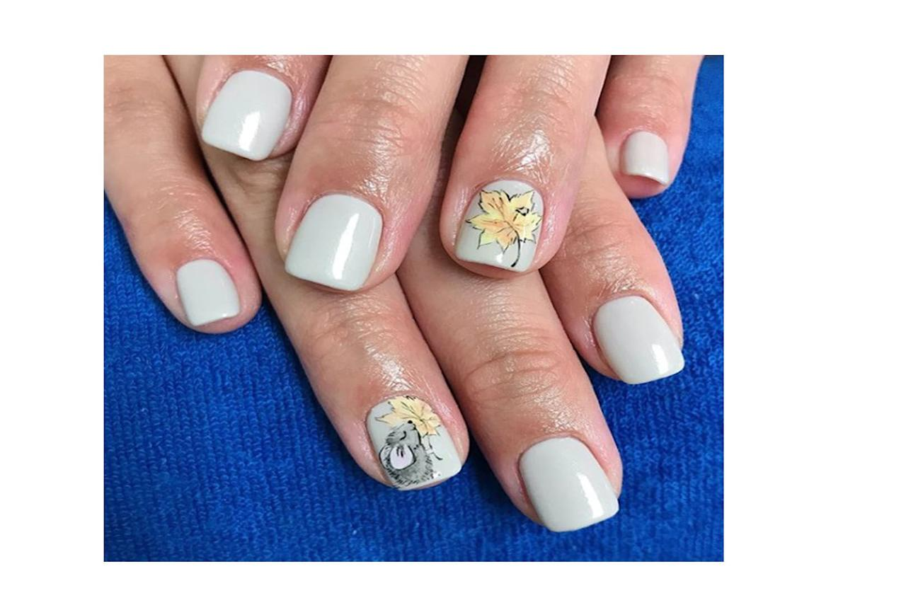 """<p>You can never go wrong with a light grey for fall, especially with these cute leaf details. Check out more designs <a href=""""https://www.instagram.com/aphroditenailstudio/"""">@aphroditenailstudio</a>.</p>"""