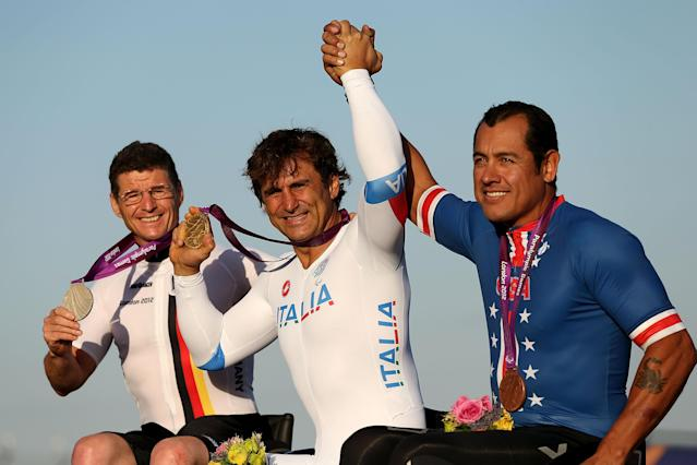 LONGFIELD, ENGLAND - SEPTEMBER 05: Norbert Mosandl of Germany, Alessandro Zanardi of Italy and Oscar Sanchez of USA celebrate on the podium after the Men's Individual H4 Time Trialon day 7 of the London 2012 Paralympic Games at Brands Hatch on September 5, 2012 in Longfield, England. (Photo by Clive Rose/Getty Images)