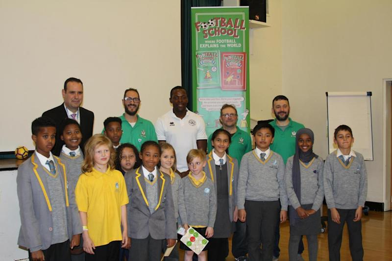 Nedum Onuoha, Ben Lyttleton, Alex Bellos and Spike Gerrell with the headteacher and pupils of Ark Swift Primary School
