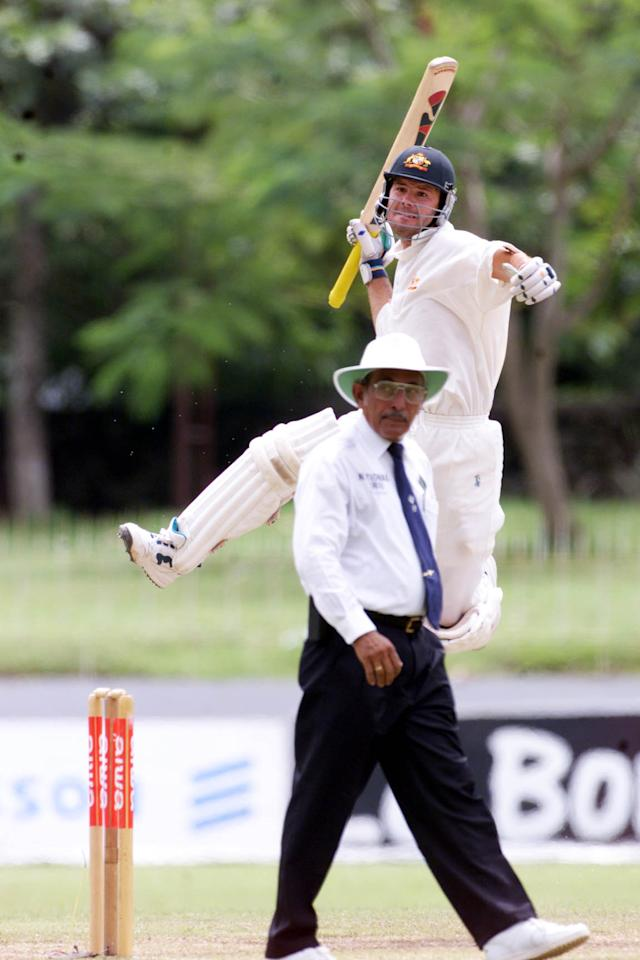 2 Oct 1999:  Ricky Ponting of Australia celebrates reaching his century with umpire KT Francis in foreground, on day three of the 3rd Test between Sri Lanka and Australia at Singhalese Sports Club, Colombo, Sri Lanka.X Mandatory Credit: Hamish Blair/ALLSPORT