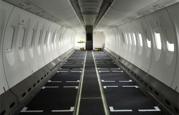 Before the pandemic, this Ethiopian Airlines plane would normally be full of people, but its seats are stripped off on Friday to make room for the cargo.